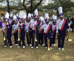 Brass section Posing before marching with Krew Femme Fatale. 2016