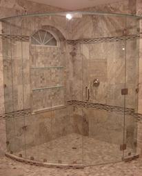 Frameless curved shower enclosure