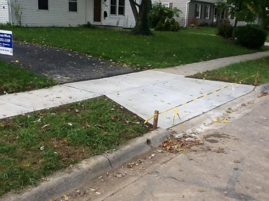 Best Sidewalk Installer Sidewalk Contractor and Cost in Council Bluffs IA | Lincoln Handyman Services