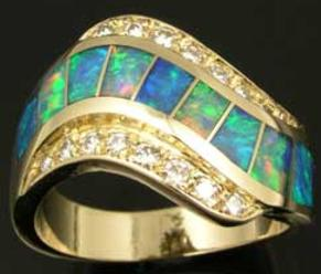 Repaired Australian opal inlay ring with diamonds.