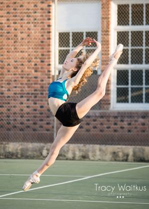 dancer leaping on a tennis court in Pismo Beach