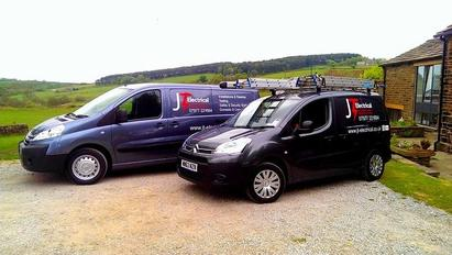 JT electrical Company vehicles
