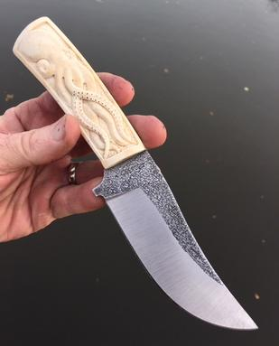 Custom AEBL stainless knife with hand carved Octopus in bone handles. www.Bergknifemaking.com
