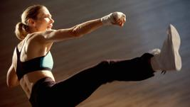 Fitness teacher performing a Kick boxing class for weight loss and body conditioning