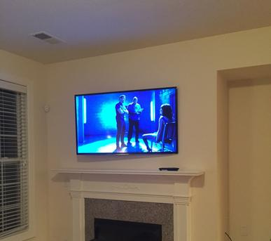 Flat Screen, plasma, lcd, 4k, curved tv mount installation over fireplace in Charlotte NC< Waxhaw, NC, Matthews, Pinevile, Fort Mill SC, Rock Hill and Indian Land SC