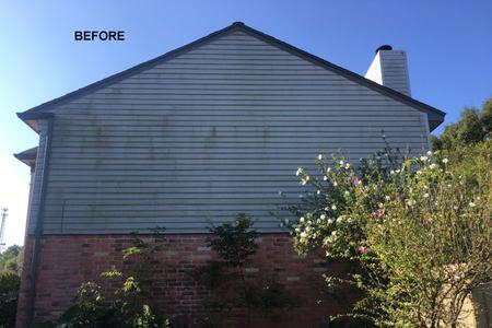 house wash cleaning siding in Houston TX before