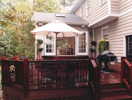 Ipe deck with Andersen french doors leading to interior of sunroom.