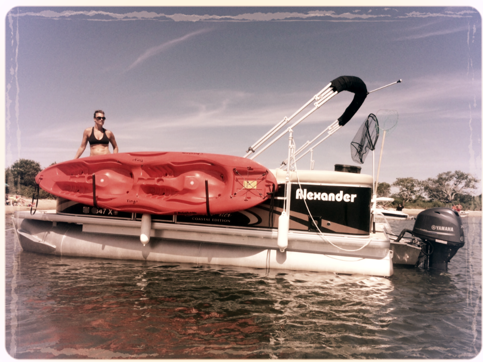 ToonRacker Kayak Loaded on an Alexander Pontoon Boat with Yamaha 70