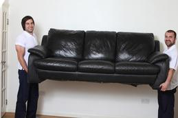 2 men removing couch