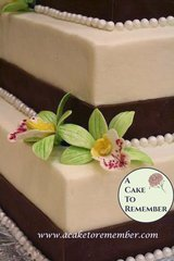 Gumpaste orchid, sugar flower for cake decorating, wedding cakes, cake toppers.