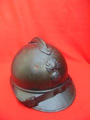 French infantry soldiers Adrian helmet original dark blue paintwork and its badge,leather liner and chin strap found on the Somme battlefield
