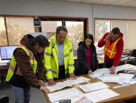 Photo of Construction Management Team Members Collaborating