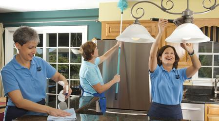 House Cleaning. Three maids deep cleaning a kitchen. Deep Cleaning. Professional Cleaning.