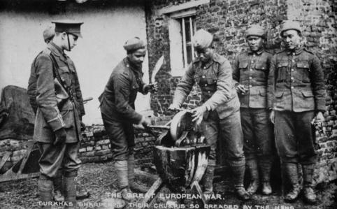 Gurkha soldiers in the First World War sharpening their kukris