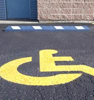 blue and white parking block in handicap parking area