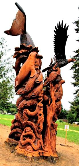 Massive stump carving totem. Wild life totem. Gig Harbor, WA totem at Crescent Creek Park, chainsaw carver in Washington state.