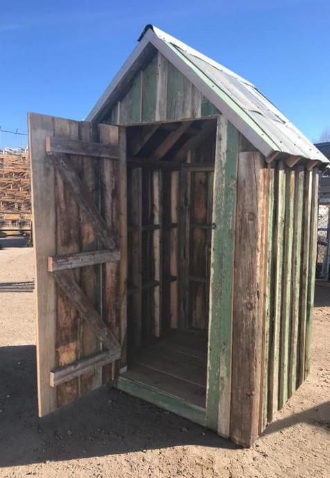Outhouse. Reclaimed wood with metal roofing