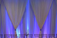 Specialty lighting and pipe draping at wedding reception in Bay St. Louis MS