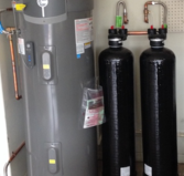 Descaler filtration system with hybrid hot water heater.