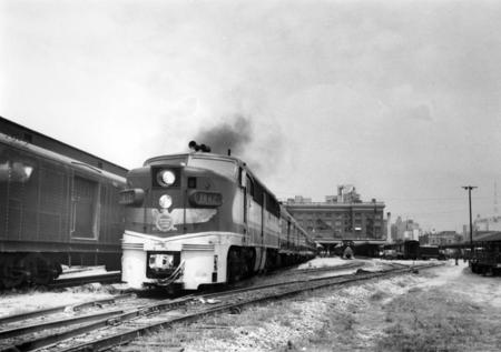 "Missouri Pacific's ""Valley Eagle"" train No. 11, southbound, headed by diesel locomotive No. 8005 , departing from the Houston Union Station, en route to Brownsville, Texas on the morning of July 12, 1953."
