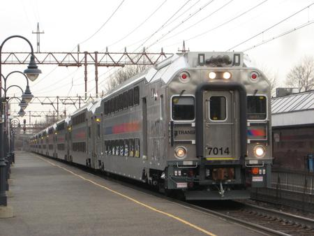 NJ Transit Multilevel train 6651, led by No. 7014, stops at the Millburn Station. All vehicles on this train are manufactured by Bombardier.