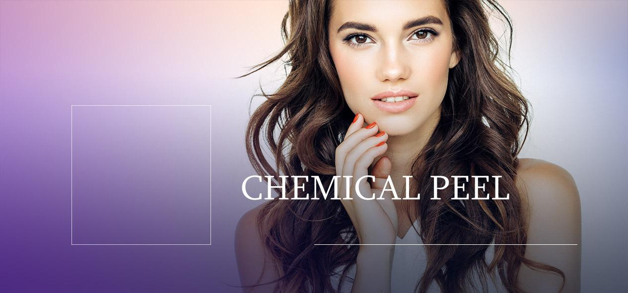 Model in white looking at camera. Learn about Chemical Peels below!
