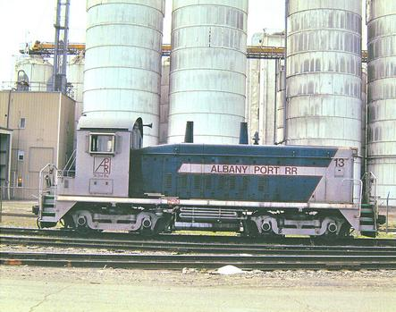 An EMD SW9 switcher stands in front of the Cargill Silos at the Port of Albany-Rensselaer.