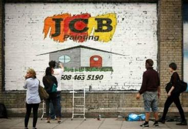 Jcb Painting Logo painted on brick wall.