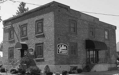Black and White photo of Fuller Insurance Agency office building in Carthage, NY