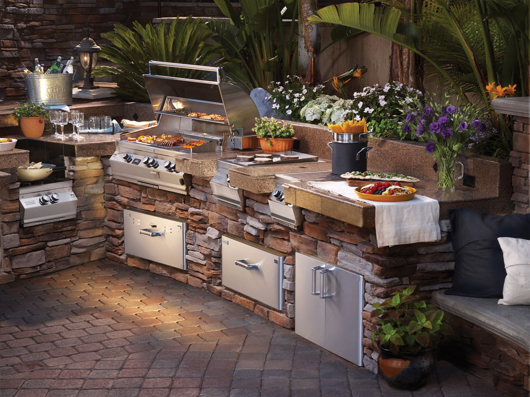 outdoor kitchens, living areas, brick pavers, coping and pools