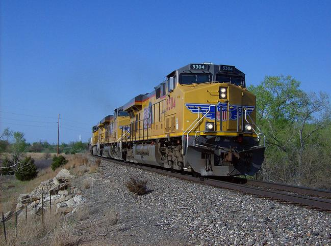 Three of Union Pacific Railroad's Evolution Series locomotives leaving Hutchinson, Kansas with AC45CCTE No. 5304 in the lead.