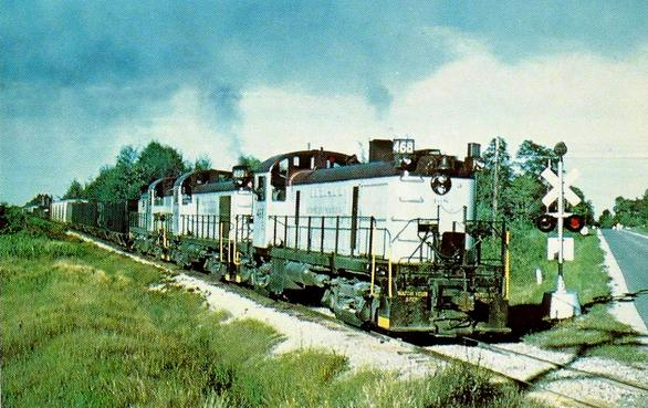 Postcard photo of D&M's Symbol Freight #AB-2 south of Tawas City, MI with Alco RS-2 no. 468 on the lead. July, 1976.