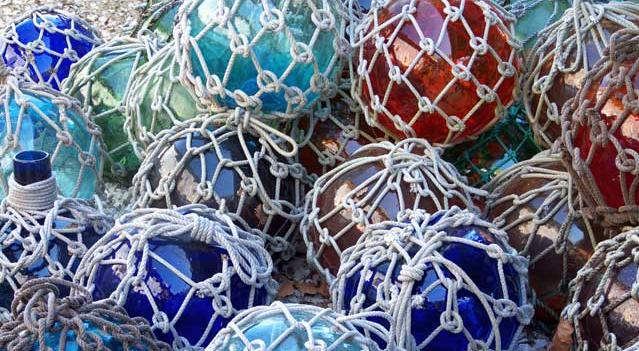 Blue, red and green glass balls wrapped in cotton netting