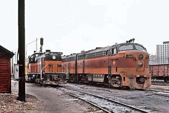 MILW 26A, a Loewy-designed Fairbanks Morse C Liner CFA16-4 and 462, an ALCO RS3 at Madison, WI in April of 1965.
