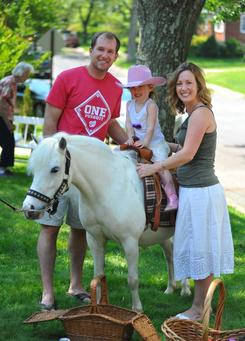 portrait photo of mother and father with daughter at her cowgirl pony party on Sparkle Plenty