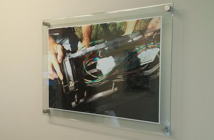 Photo of frameless picture frame with standoffs