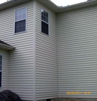 A vinyl sided house that was covered in mold, mildew, dirt, and grime after the soft washing by A1 Pressure Washing
