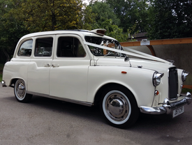 Classic London Taxi Wedding Car in Ivory - Essex Wedding Cars