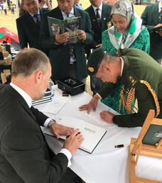 Signing a copy of the new Gurkha book for the Brunei Defence Attache