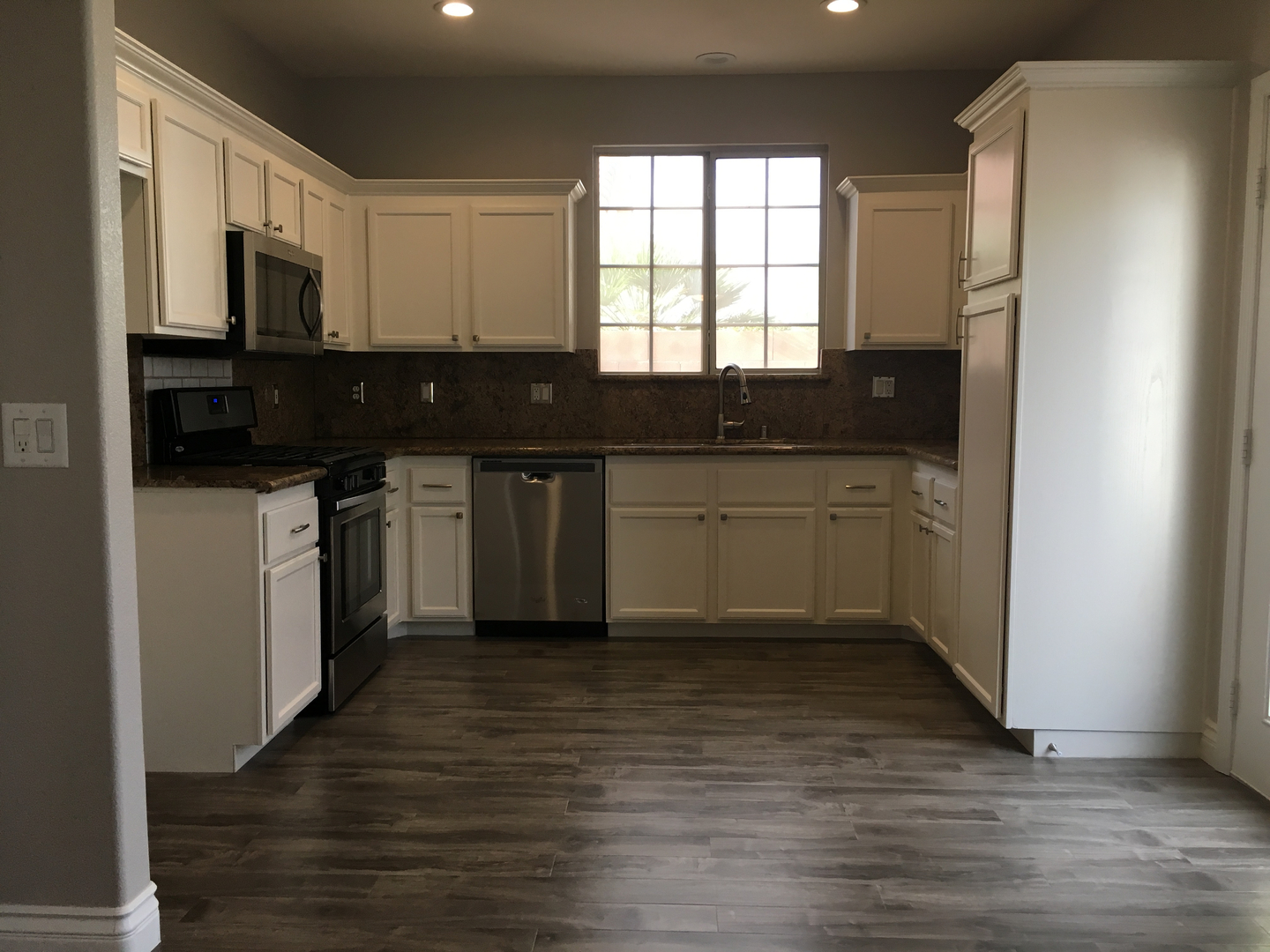 services kitchen remodel las vegas Inexpensive bathroom remodel new granite installed and cabinet refinished before