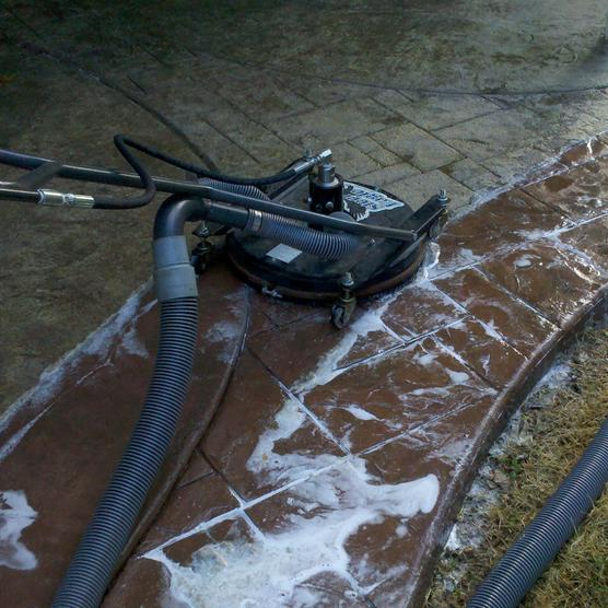 Clean It Right, professional pressure washing cleaning pavers on driveway or sidewalk