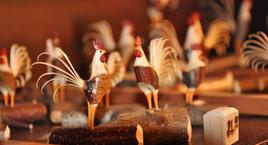 hand-carved rooster figurines