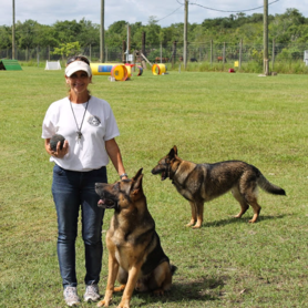 One of our dog trainers with dog in Melbourne, FL