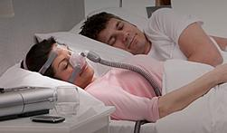 Couple sleeping with CPAP