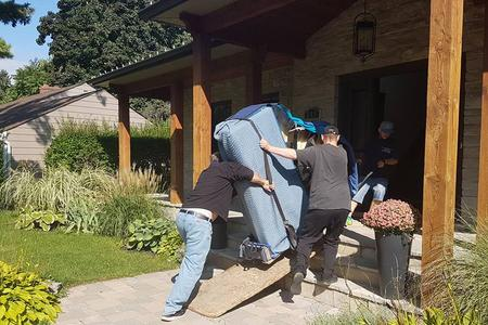 Professional piano movers setting up a piano in Toronto