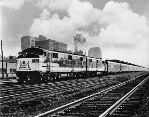 The Humming Bird train No. 5, southbound, at depot in Birmingham, Alabama, en route from Cincinnati to New Orleans, July 1954.