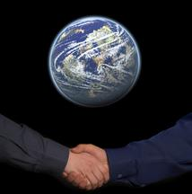 Handshake with a globe above