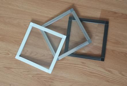 Photo of three cusom made window screens