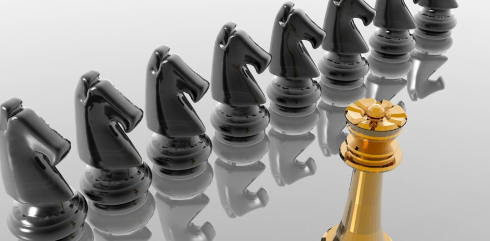 Black chess knights led by gold king