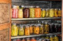 Shelves full of food in glass jars